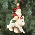 santa claus with bag on polar bear ornament