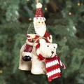 santa with tree riding polar bear ornament