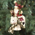 santa with pine bough and polar bear ornament