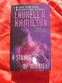 A STROKE OF MIDNIGHT-LAURELL K HAMILTON