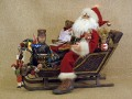 Classic Santa Claus Figurine in Vintage Sleigh Lighted