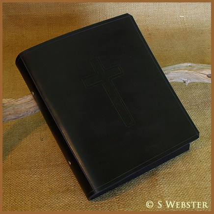 A5 BLACK CRUCIFIX BINDER LAYING.jpeg