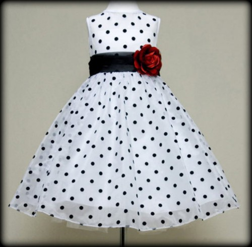 White flower girl dress with black polka dots