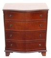 Antique small serpentine front mahogany chest of drawers