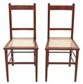 Antique pair of Edwardian inlaid mahogany beech bedroom side chairs cane