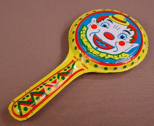Vintage Metal Noise Maker With A Clown Face On Each Side, 5 Inches Long, Tin Toy