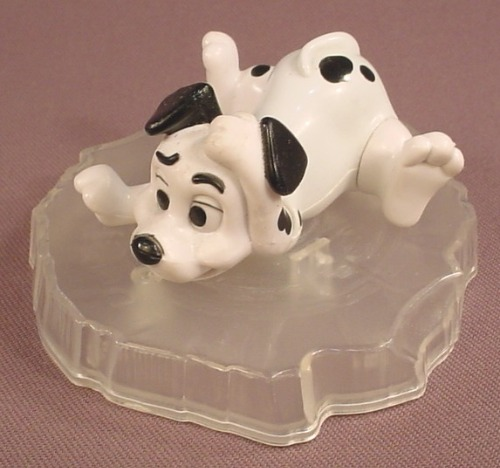McDonalds 101 Dalmatians Dog Sitting On An Ice Floe, The Dog Spins As It Rolls Long, 102