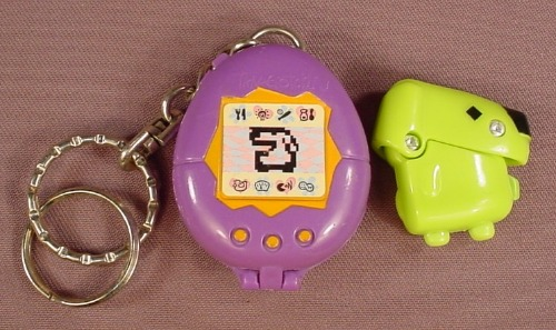 McDonalds 1998 Tamagotchi Keychain With A Green Dog Figure That Fits Inside, Non Electronic