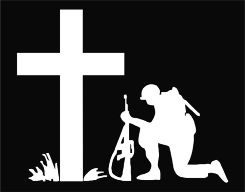 Soldier kneeling at the Cross.jpeg
