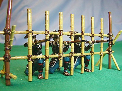 Monarch Regalia 270: Ishida Clan Teppo - 5 Ashigaru kneeling, firing + 1 Samurai