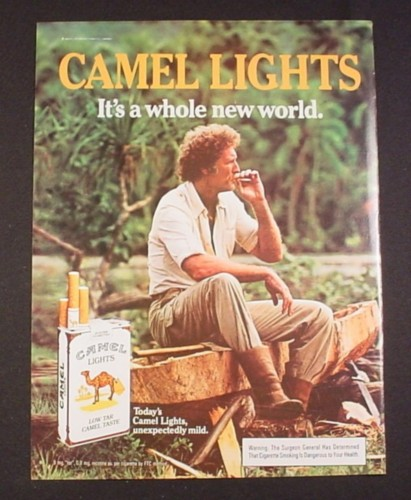 Magazine Ad for Camel Lights Cigarettes, 1984, Man on a Dugout Canoe