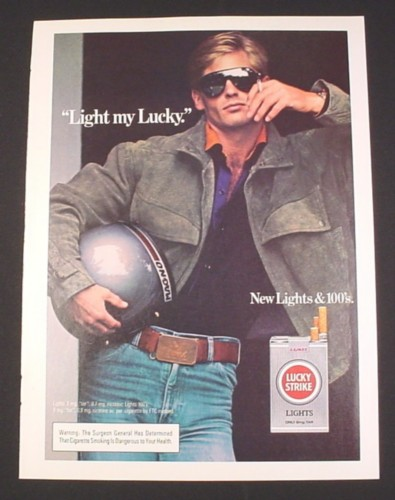 Magazine Ad for Lucky Strike Lights Cigarettes, 1985, Man with Motorcycle Helmet