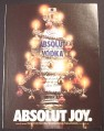 Magazine Ad for Absolut Joy, Absolut Vodka, Bottle Wrapped As a Christmas Tree