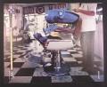 Magazine Ad for Sony Walkman, Blue ET Alien in Barber Chair, 2000, 10 by 12