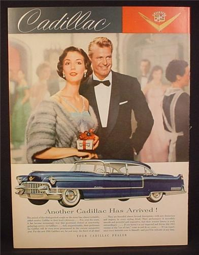 Magazine Ad for Cadillac Blue Car, Side View, Man in Tuxedo, Woman in Fur, 1954