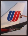 Magazine Ad For United Airline, Worker Cleaning The Logo On The Tail Of A Jet, 1985