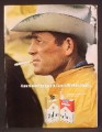 Magazine Ad For Marlboro Cigarettes, Cowboy In Yellow Rain Slicker, Edges of Hat are Wet, 1970