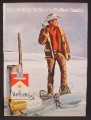 Magazine Ad For Marlboro Cigarettes, Cowboy In Snowshoes on Fence Line, 1972, 8 1/4 by 11 1/8