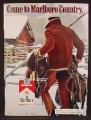 Magazine Ad For Marlboro Cigarettes, Cowboy in Snow Carrying a Saddle & Blanket, 1972