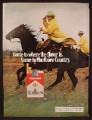 Magazine Ad For Marlboro Cigarettes, 2 Cowboys In Yellow Slickers Riding Hard, 1974