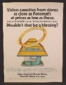 Magazine Ad For Fotomat Hut with Yellow Roof, Halo, Beta & VHS Video Cassettes, 1979