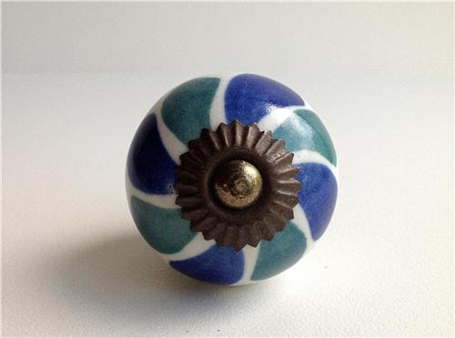 Blue And Green Mixed Wheel On White Porcelain Cabinet