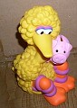 Big Bird holding a piggy bank 1996 Jim Henson Productions Inc.