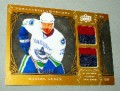 2009-10 Artifacts Treasured Swatches Daniel Sedin #41 of #50.jpeg