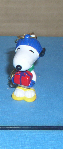 Peanuts Snoopy dog full body holding a present Ornament