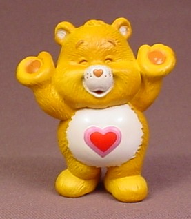 Care Bears Tenderheart PVC Figure With Arms Raised, Eyes Closed, 2 1/2 Inches Tall, Figurine