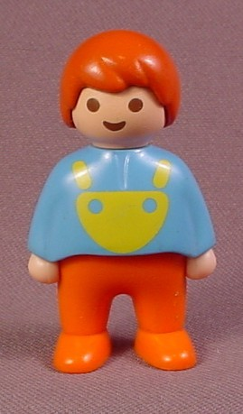 Playmobil 123 Boy Child Or Baby Figure In A Blue Shirt With A Yellow Bib, Orange Pants, Brown Hair