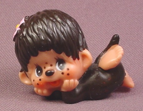 """Monchhichi Vintage 1979 PVC Figure, Laying on Floor with Pink Flower in Hair, 1 7/8"""" tall"""