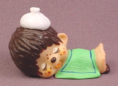 "Monchhichi Vintage 1979 PVC Figure, Sick with Ice Bag on Head, Green Blanket, 2 1/8"" tall"
