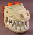 Fisher Price Imaginext Dinosaur Skeleton Skull Head with Sounds & Eyes That Light Up, H5341