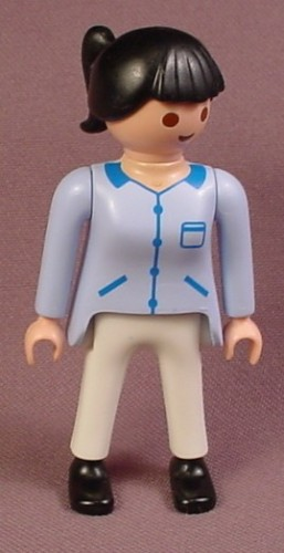 Playmobil Adult Female Nurse Figure In A Light Blue Long Sleeve Shirt With Blue Pockets & Zippers
