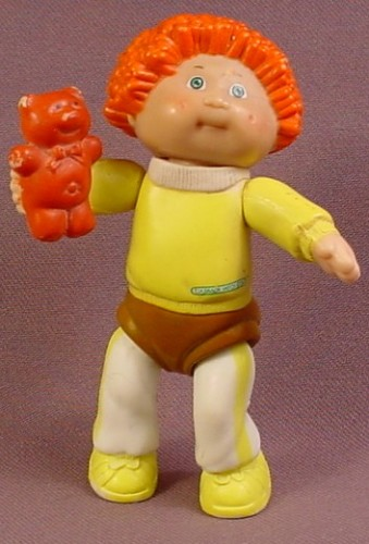 Cabbage Patch Kids Poseable PVC Figure With Orange Hair Holding A Brown Teddy Bear