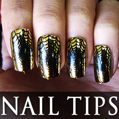 54202-3-THUMB 24pcs Pre-Design metallic false nail full tips.jpg 12/12/2011