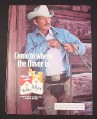 Magazine Ad for Marlboro Cigarettes, 1984, Cowboy putting pack in pocket