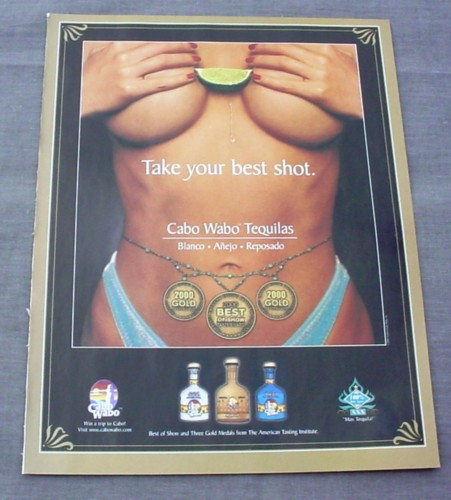 Magazine Ad for Cabo Wabo Tequilas 2000 Lime Between Breasts