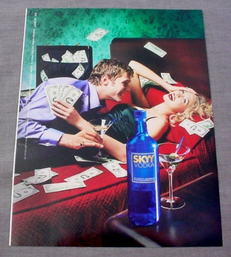 Magazine Ad for Skyy Vodka #30 Jackpot, 2000, Man & Woman on Bed