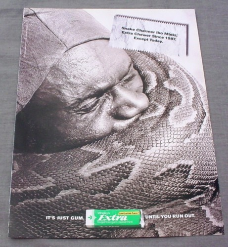 Magazine Ad for Extra Gum, 2001, Snake Coiled Around Charmer