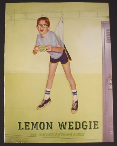 Magazine Ad for Altoids Lemon Wedgie, Boy Hung on Coat Rack by Underwear, 2003
