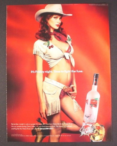 Magazine Ad for Cherry Bomb Vodka, Sexy Woman in Cowgirl Outfit, Time To Light The Fuse, 2004