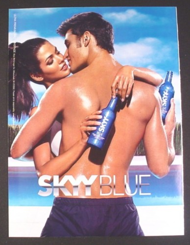 Magazine Ad for Skyy Blue Vodka, Man & Woman with Bottles, 2002