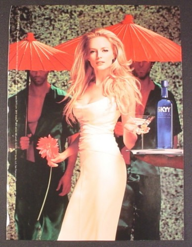 Magazine Ad for Skyy Vodka, #13 Entourage, Sexy Model with 2 Men Holding Umbrellas, 2005