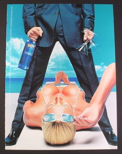 Magazine Ad for Skyy Vodka, #49 Riviera Rendezvous, Man Standing Over Sexy Woman, 2000