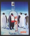 Magazine Ad for Smirnoff Vodka, Penguins, Looking Through Bottle One Wears A Tuxedo, 1994