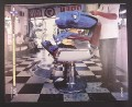 Magazine Ad for Sony Walkman, Blue ET Alien in Barber Chair, 2000, 10 by 12