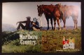 Magazine Ad for Marlboro Cigarettes, 2 Cowboys with Horses Sitting On A Hill, 1970, Double Page