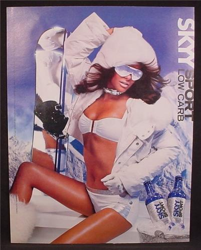 Magazine Ad For Skyy Sport Vodka, Sexy Woman In White Bathing Suit & Parka, 2004, 9 1/2 by 12